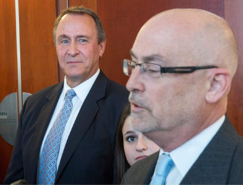 Rick Egan  |  The Salt Lake Tribune  Former Attorney General Mark Shurtleff and his daughter Annie listen as attorney Richard Van Wagoner talks to the media after Shurtleff's scheduling hearing at the Matheson Courthouse, Monday, March 23, 2015. Third District Court Judge Randall Skanchy set a June 15 date for a hearing to determine whether Shurtleff will stand trial on bribery and corruption charges.