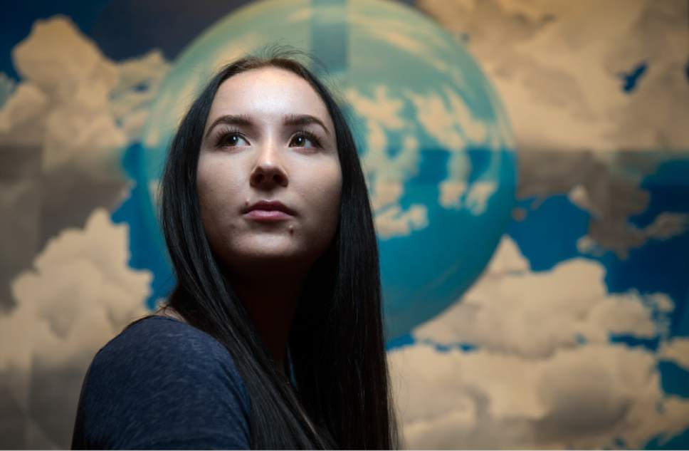 """Leah Hogsten     The Salt Lake Tribune The Salt Lake Tribune's Utahn of the Year--Madi Barney, pictured Wednesday, December 22, 2016, in front of an oil painting by Utahn Lee Cowan entitled """"Heed the Firmament to the Eighth"""", 2014, part of the collection at the Springville Art Museum. Through Barney's willingness to go public about Brigham Young Universityís handling of her rape case, she changed the discussion on campus sexual assault across the state. Barney launched a petition requesting Honor Code amnesty for BYU students who report sex crimes that resulted in the school's policy change not to punish sexual assault victims for Honor Code violations in connection with their reports."""