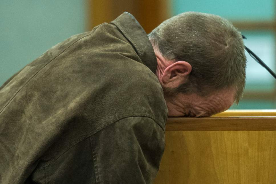 Chris Detrick  |  The Salt Lake Tribune Kenneth Lee Drew puts his face on the lectern during his sentencing at 4th District Court in American Fork on Tuesday. Judge Robert Lunnen sentenced Drew to one to fifteen years in the Utah State Prison for his role in the death of Ashleigh Holloway Best in 2016.