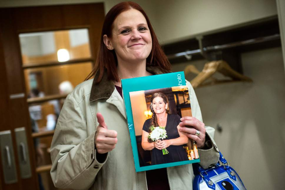 Chris Detrick  |  The Salt Lake Tribune Buffee Best holds a photograph of her sister-in-law Ashleigh  Best after the sentencing of Kenneth Lee Drew at 4th District Court in American Fork Tuesday January 10, 2017. Judge Robert Lunnen sentenced Drew to one to fifteen years in the Utah State Prison for his role in the death of Ashleigh Holloway Best on May 17, 2016.