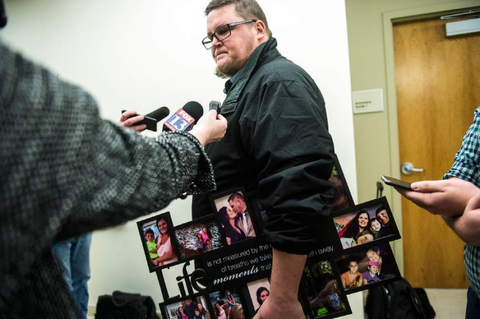 Chris Detrick  |  The Salt Lake Tribune Brennen Best holds photographs of his wife Ashleigh Best and their children while talking to members of the news media after the sentencing of Kenneth Lee Drew at 4th District Court in American Fork Tuesday January 10, 2017. Judge Robert Lunnen sentenced Drew to one to fifteen years in the Utah State Prison for his role in the death of Ashleigh Holloway Best on May 17, 2016.