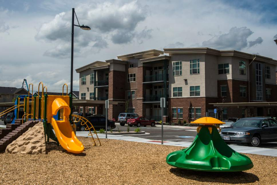 Chris Detrick  |  Tribune file photo The playground and exterior of housing units at Canyon Crossing at Riverwalk Wednesday May 27, 2015.  Canyon Crossing at Riverwalk is a  10-building affordable housing community in Midvale. The $36 million development completed in 2015 creates 180 apartments for low-income families in the area and was made possible through a $13 million Low-Income Housing Tax Credit investment by American Express syndicated by Enterprise Community Investment.