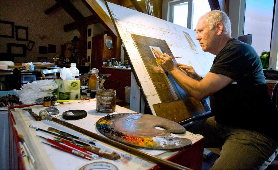 Tribune file photo James C. Christensen paints in his Orem studio in 2008.
