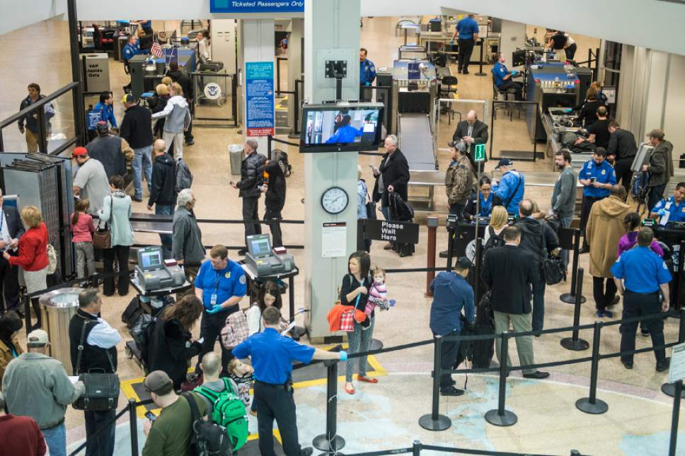 Chris Detrick  |  Tribune file photo Passengers go through security at Salt Lake City International Airport. which has surpassed 23 million passengers in a 12-month period for the first time.
