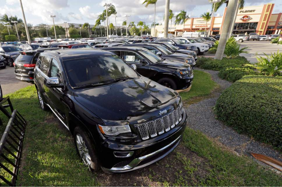 FILE - In this Thursday, Nov. 5, 2015, file photo, 2015 Jeep Grand Cherokees appear on display at a Fiat Chrysler dealership in Doral, Fla. On Thursday, Jan. 12, 2017, the U.S. government alleged that Fiat Chrysler Automobiles installed and failed to disclose to regulators software in some Jeep Grand Cherokees with diesel engines that allowed the vehicle to emit nitrous oxide above the allowable limits. (AP Photo/Alan Diaz, File)