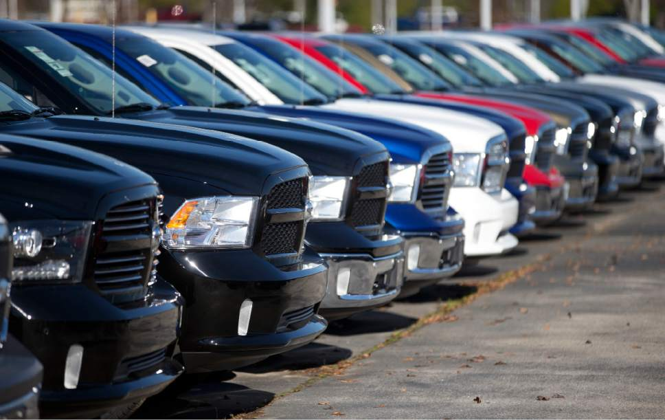 """FILE - In this Jan. 5, 2015, file photo, Ram pickup trucks are on display on the lot at Landmark Dodge Chrysler Jeep RAM in Morrow, Ga. On Thursday, Jan. 12, 2017, the U.S. government alleged that Fiat Chrysler Automobiles failed to disclose that software in some of its pickups and SUVs with diesel engines allows them to emit more pollution than allowed under the Clean Air Act. The Environmental Protection Agency said in a statement that it issued a """"notice of violation"""" to the company that covers about 104,000 vehicles, including the 2014 through 2016 Jeep Grand Cherokee and Dodge Ram pickups, all with 3-liter diesel engines. (AP Photo/John Bazemore, File)"""