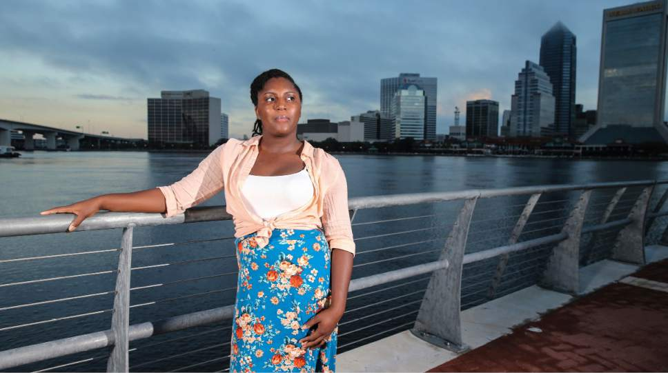 In this Thursday, Oct. 20, 2016, photo, Asia Howard poses for a photo at St. Johns River Park at sunrise, in Jacksonville, Fla. Howard was stuck in mostly retail and fast-food jobs after graduating high school, unable to get a job in banking, a profession she prized for its steady hours. After further developing her career and computer skills, she landed a job in mortgage lending that paid nearly double what she earned in previous jobs. Howard is now studying for an associate's degree in business administration at Florida State College at Jacksonville. (AP Photo/Gary McCullough)