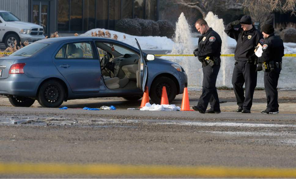 Al Hartmann  |  The Salt Lake Tribune  West Valley City Police investigate shooting scene at 4900 West off the frontage road to SR 201 where a husband shot his wife in the car and then shot himself.  Both are in critical condition.