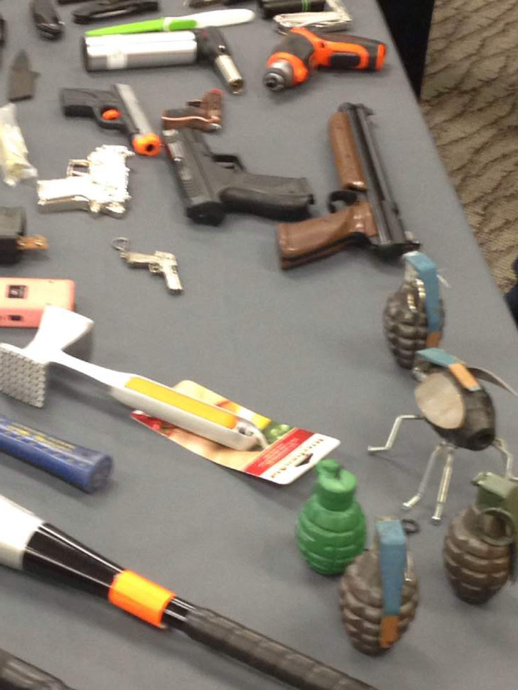 Lee Davidson  |  Tribune file photo  A table full of prohibited items seized last year at Salt Lake City International Airport includes inert or fake grenades, guns, knives, clubs and tools.