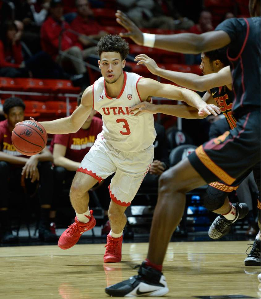 Francisco Kjolseth | The Salt Lake Tribune Utah Utes guard Devon Daniels (3) drives the ball agains USC during the first half of the NCAA college basketball game at the Huntsman Center in Salt Lake City, Thursday, Jan. 12, 2017.