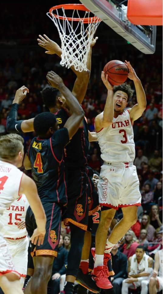 Francisco Kjolseth | The Salt Lake Tribune Utah Utes guard Devon Daniels (3) tries to push past USC during the second half of the NCAA college basketball game at the Huntsman Center in Salt Lake City, Thursday, Jan. 12, 2017.