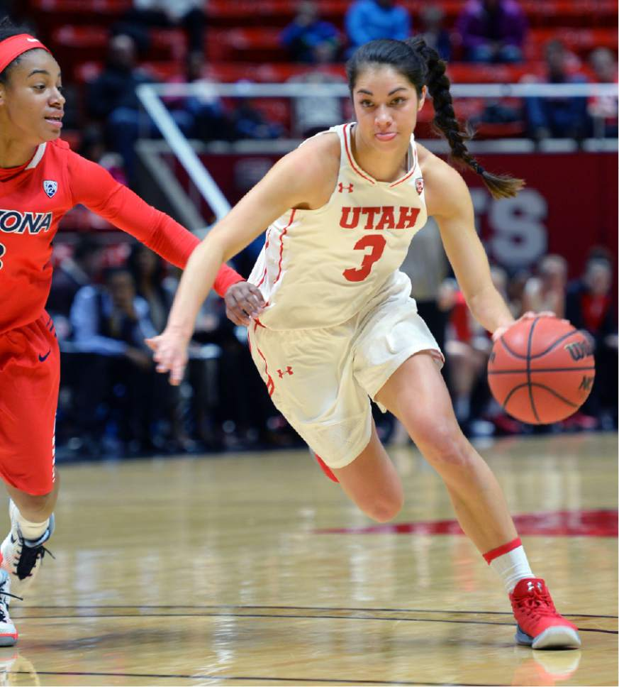 Steve Griffin / The Salt Lake Tribune  Utah Utes forward Malia Nawahine (3) drives into the lane  during Pac-12 game against Arizona at the Huntsman Center in Salt Lake City Sunday January 8, 2017.