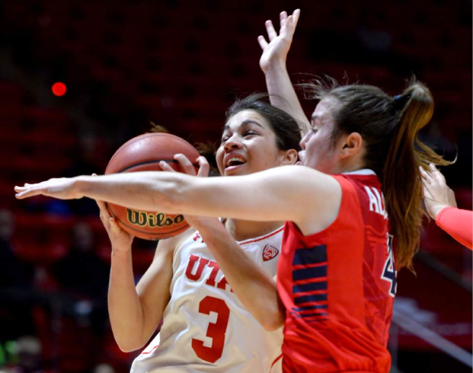 Steve Griffin / The Salt Lake Tribune  Utah Utes forward Malia Nawahine (3) gets fouled by Arizona Wildcats guard Lucia Alonso (4) during Pac-12 game against Arizona at the Huntsman Center in Salt Lake City Sunday January 8, 2017.