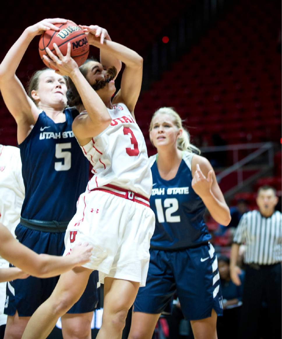 Lennie Mahler  |  The Salt Lake Tribune  Utah State's Shannon Dufficy forces a jump ball as Utah's Malia Nawahine shoots in a game at the Huntsman Center in Salt Lake City, Saturday, Dec. 3, 2016.