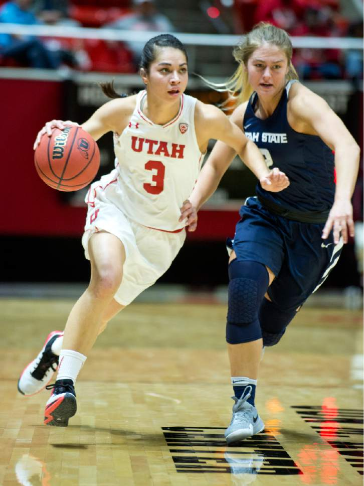 Lennie Mahler  |  The Salt Lake Tribune  Utah's Malia Nawahine brings the ball up the court as Utah State's Jessie Geer defends in a game at the Huntsman Center in Salt Lake City, Saturday, Dec. 3, 2016.