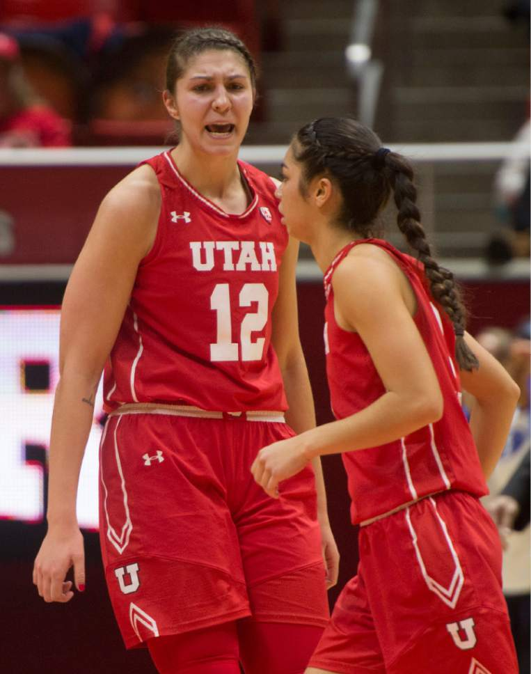 Rick Egan  |  The Salt Lake Tribune  Utah Utes forward Emily Potter (12) shouts its  Malia Nawahine (3), after Nawahine hit a 3-point-shot to tie the game, in Basketball action, Brigham Young Cougars vs. the Utah Utes, Saturday, December 10, 2016.