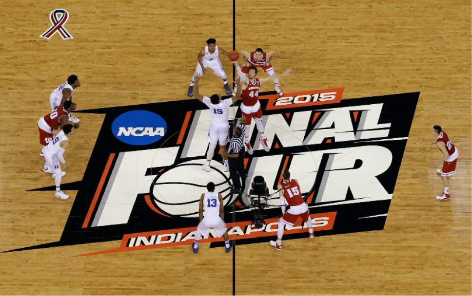 Duke's Jahlil Okafor (15) and Wisconsin's Frank Kaminsky (44) battle for the ball at the tip off during the first half of the NCAA Final Four college basketball tournament championship game Monday, April 6, 2015, in Indianapolis. (AP Photo/David J. Phillip)