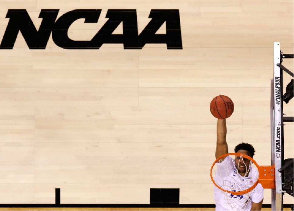 Duke's Jahlil Okafor dunks the ball during the first half of the NCAA Final Four college basketball tournament championship game against Wisconsin Monday, April 6, 2015, in Indianapolis. (AP Photo/Michael Conroy)