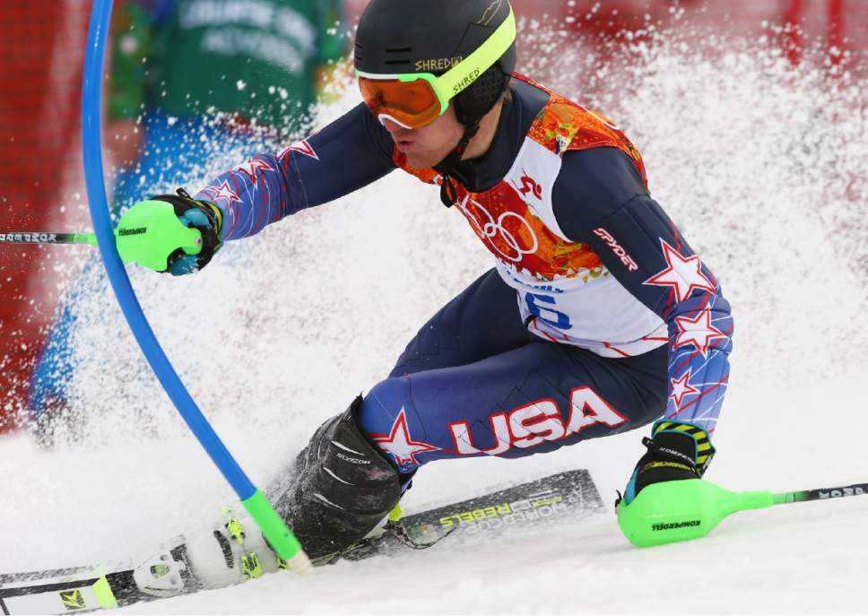United States' Ted Ligety skis during the first run of the men's slalom at the Sochi 2014 Winter Olympics, Saturday, Feb. 22, 2014, in Krasnaya Polyana, Russia. (AP Photo/Alessandro Trovati)