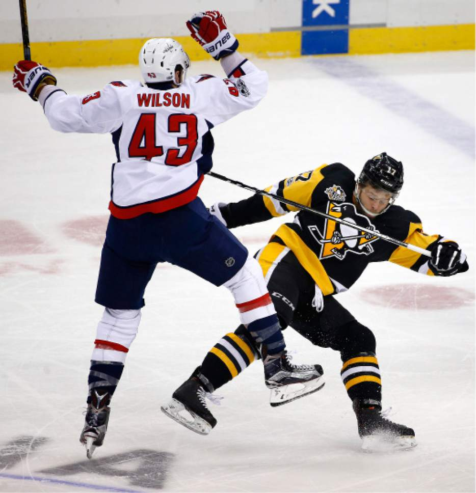 2236dfa0acd Pittsburgh Penguins  Bryan Rust (17) collides with Washington Capitals  Tom  Wilson (