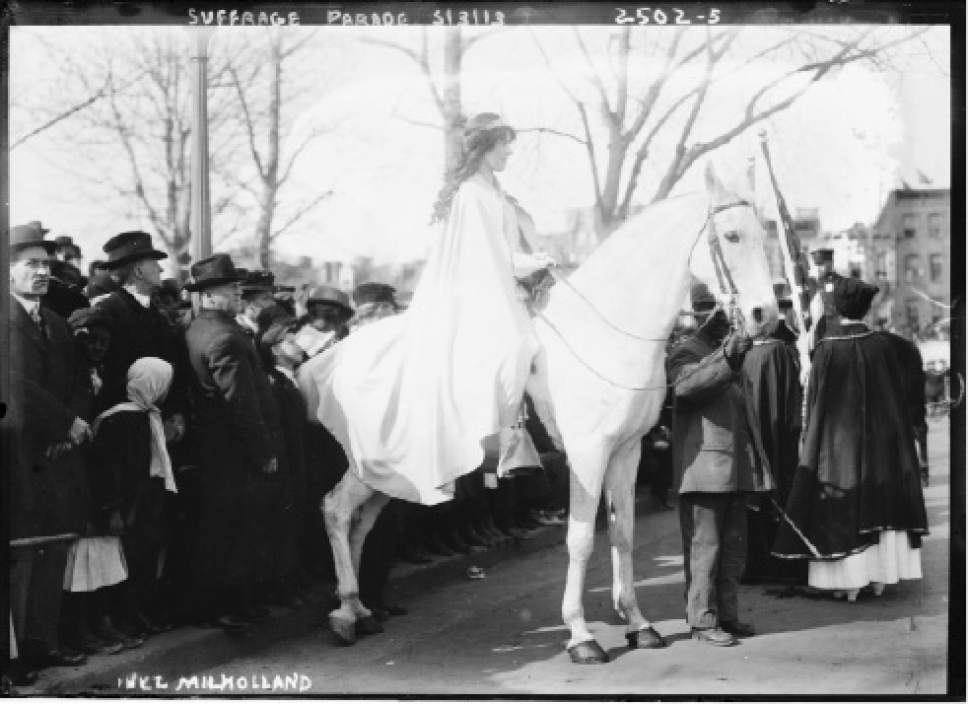 In this photo provided by the Library of Congress, taken in 1913, attorney Inez Milholland Boissevain rides astride suffrage parade in Washington as the first of four mounted heralds. Thousands of women take to the streets of Washington, demanding a greater voice for women in American political life as a new president takes power. This will happen on Saturday, Jan. 21, 2017, one day after the inauguration of Donald Trump. This DID happen more than 100 years ago, one day before the inauguration of Woodrow Wilson. (Library of Congress via AP)