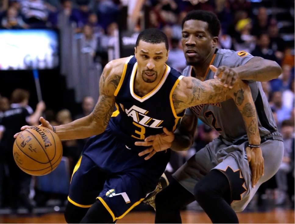 promo code 22f11 c4cf2 Utah Jazz guard George Hill (3) drives past Phoenix Suns guard Eric Bledsoe  in