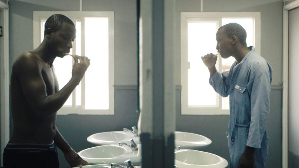 """Deputy team captain Paul brushing his teeth before setting off for work in a scene from """"The Workers Cup,"""" directed by Adam Sobel. Courtesy  