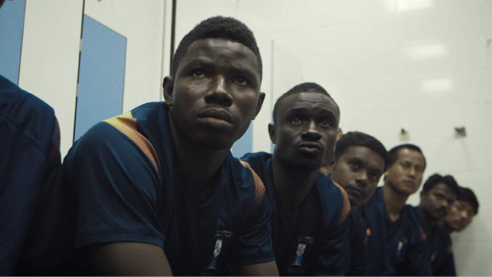 """The team in the changing room before a big match. (Left to right) Kenneth, David, Binumon, Purna, Umesh, Padam in a scene from """"The Workers Cup,"""" directed by Adam Sobel. Courtesy  