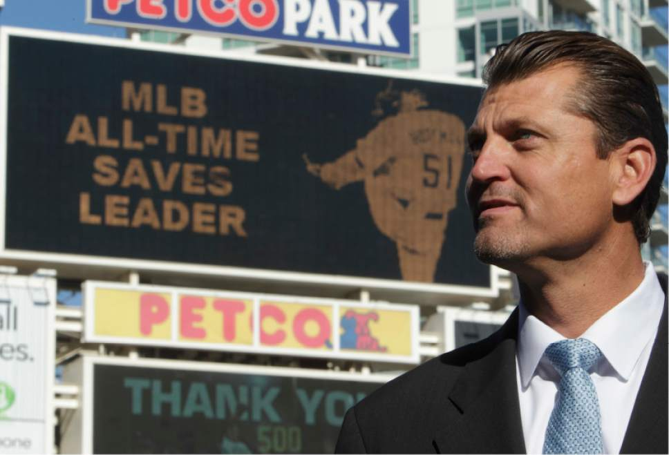 FILE - In this Jan. 12, 2011, file photo, former baseball pitcher Trevor Hoffman speaks to journalists after announcing his retirement at Petco Park in San Diego. Tim Raines and Jeff Bagwell are likely to be voted into baseball's Hall of Fame on Wednesday, Jan. 18, 2017, when Trevor Hoffman and Ivan Rodriguez also could gain the honor. (AP Photo/Gregory Bull, FIle)