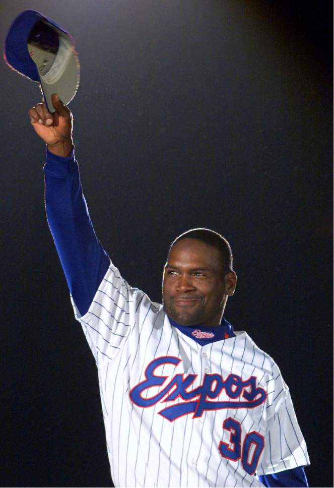 FILE - In this April 6, 2001, file photo, Montreal Expos' Tim Raines acknowledges applause from fans as he is presented before the Expos home opener in Montreal. Raines and Jeff Bagwell are likely to be voted into baseball's Hall of Fame on Wednesday, Jan. 18, 2017, when Trevor Hoffman and Ivan Rodriguez also could gain the honor. (AP Photo/Ryan Remiorz, File)