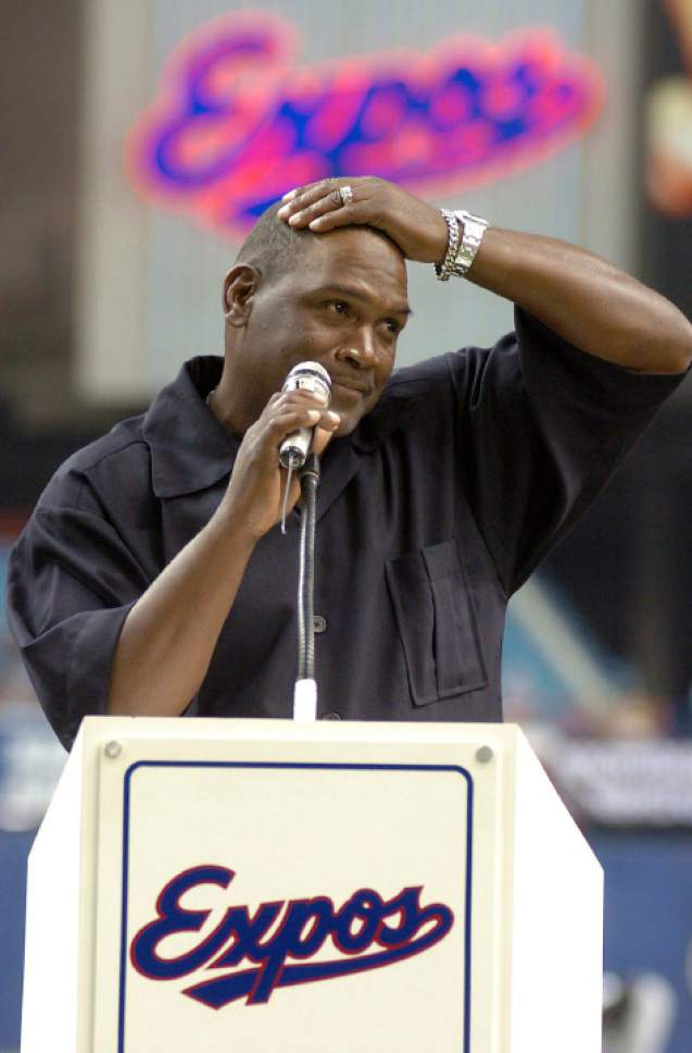 FILE - In this June 19, 2004, file photo, former Montreal Expos baseball player Tim Raines gets emotional when giving a speech to the crowd after the Montreal Expos retired his number 30 during a ceremony at the Olympic Stadium, in Montreal. Raines and Jeff Bagwell are likely to be voted into baseball's Hall of Fame on Wednesday, Jan. 18, 2017, when Trevor Hoffman and Ivan Rodriguez also could gain the honor. (Francois Roy/The Canadian press via AP, File)