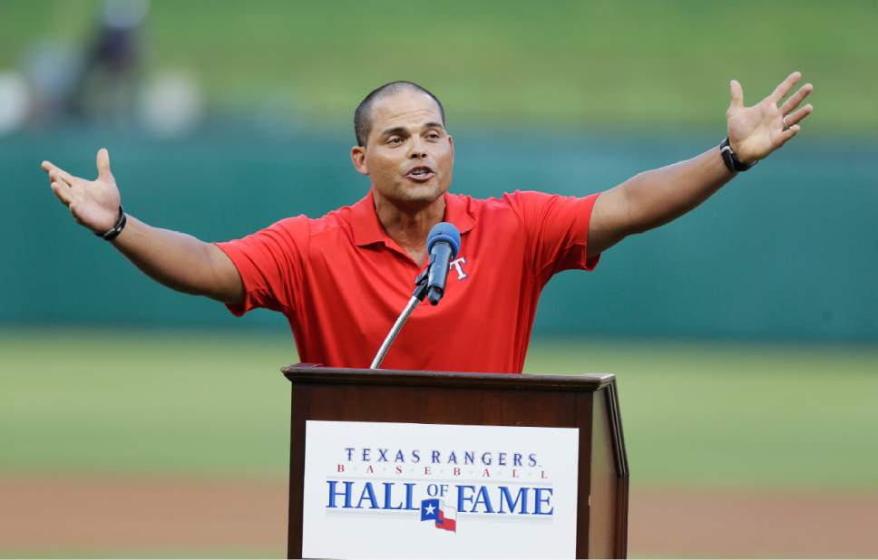 FILE - In this July 20, 2013, file photo, former Texas Rangers and 14-time All-Star catcher Ivan Rodriguez speaks after he was inducted into the Texas Rangers Baseball Hall of Fame before a baseball game between the Baltimore Orioles and the Rangers, in Arlington, Texas. Tim Raines and Jeff Bagwell are likely to be voted into baseball's Hall of Fame on Wednesday, Jan. 18, 2017, when Trevor Hoffman and Ivan Rodriguez also could gain the honor.  (AP Photo/LM Otero, File)