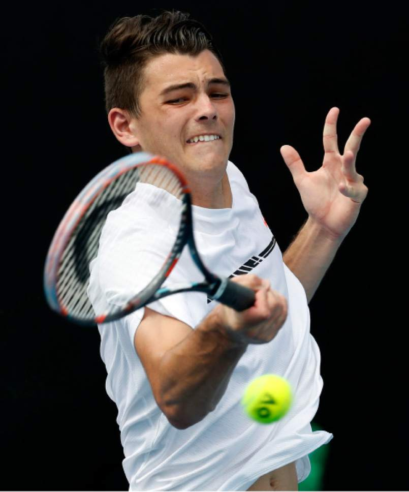 Taylor Fritz of the US plays a forehand return to Luxembourg's Giles Muller during their first round match at the Australian Open tennis championships in Melbourne, Australia, Tuesday, Jan. 17, 2017. (AP Photo/Kin Cheung)