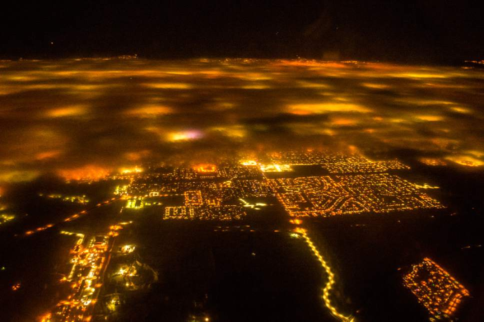 Chris Detrick  |  The Salt Lake Tribune A pollution inversion over the Salt Lake Valley as seen from an airplane returning to Salt Lake International Airport Friday December 30, 2016.