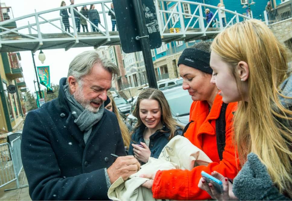 Chris Detrick  |  The Salt Lake Tribune Sam Neill signs autographs for fans during the Sundance Film Festival in Park City on Saturday, Jan.  23, 2016.