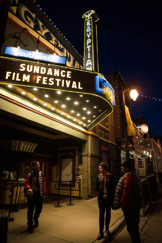 People talk outside of the Egyptian Theatre on Main Street during the first night of the 2015 Sundance Film Festival on Thursday, Jan. 22, 2015, in Park City, Utah. (Photo by Arthur Mola/Invision/AP)