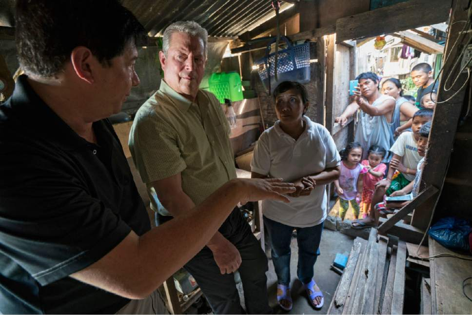 "Former Vice President Al Gore (center) talks to Alfred Romualdez (left), former mayor of Tacloban City, Philippines, and Demi Raya, a survivor of Typhoon Haiyan, in the Raya family home in Tacloban City on March 12, 2016. The moment is captured in a documentary, a sequel to ""An Inconvenient Truth,"" that will open the 2017 Sundance Film Festival on Jan. 19, 2017. Jensen Walker  