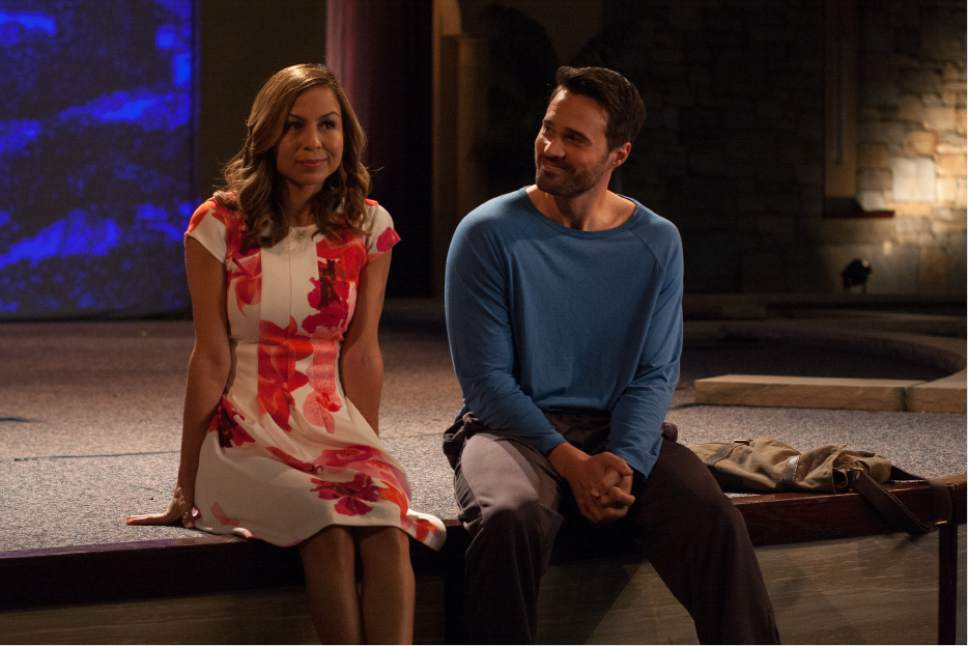 """Gavin Stone (Brett Dalton' right), a former child star, has a quiet moment with Kelly (Anjelah Johnson-Reyes), a pastor's daughter who is directing their church's Passion production, in the comedy-drama """"The Resurrection of Gavin Stone."""" Eric Lee  