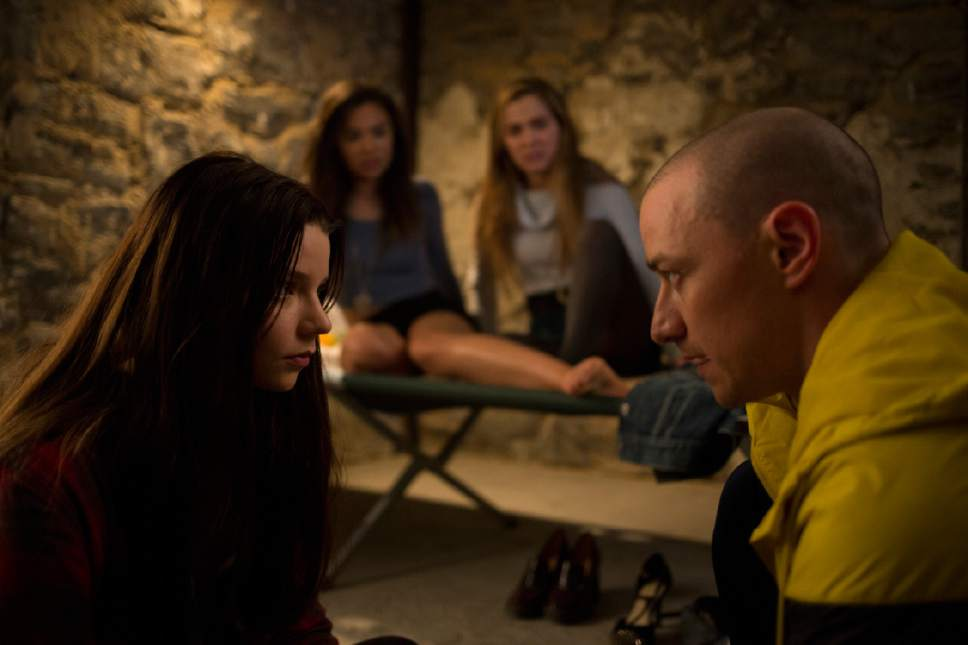 """This image released by Universal Pictures shows Anya Taylor-Joy, left, and James McAvoy, right, in a scene from, """"Split."""" (John Baer/Universal Pictures via AP)"""