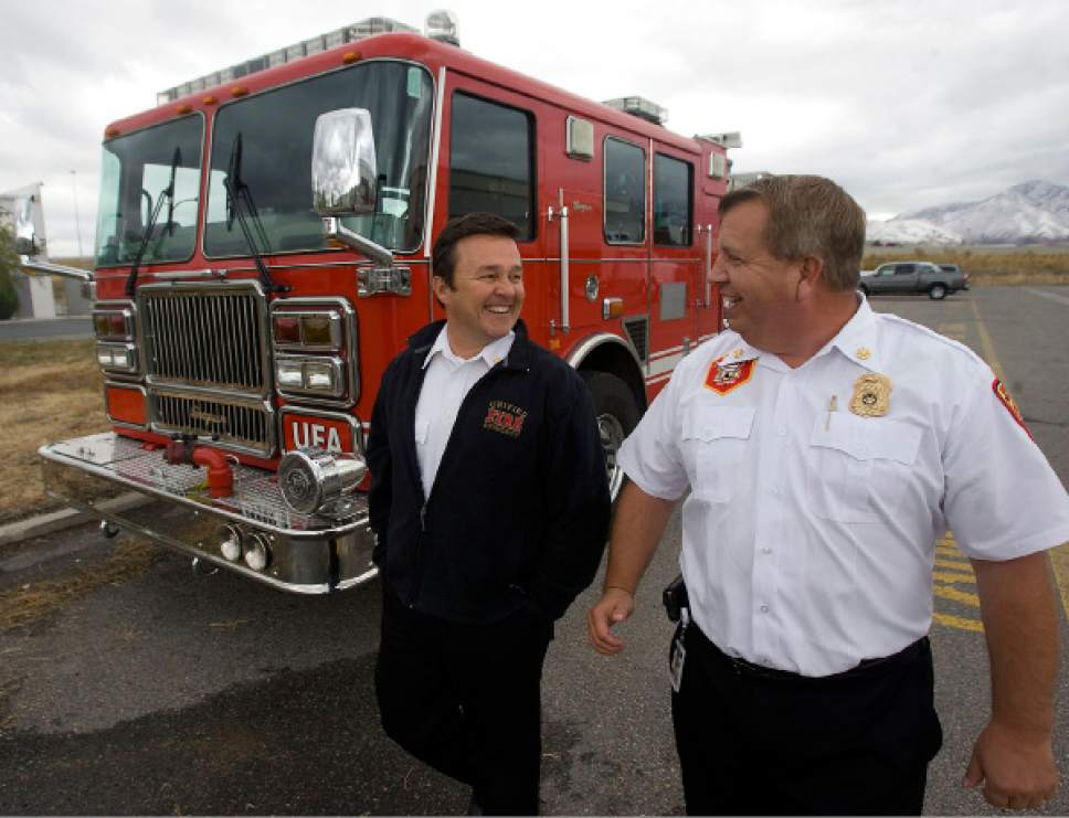Al Hartmann  |  Tribune file photo  Former Unified Fire Authority Chief Michael Jensen, left, and Deputy Chief Gaylord Scott in October 2010. A recent audit recommends a criminal investigation related to their spending at UFA.
