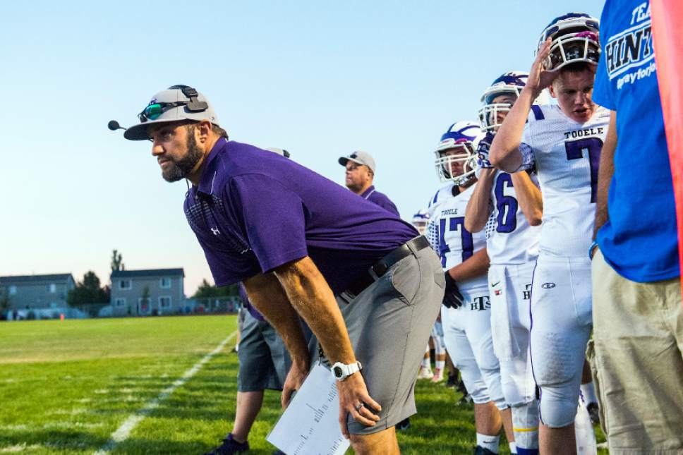 Chris Detrick  |  The Salt Lake Tribune Tooele coach Kyle Brady watches during the game at Stansbury High School Friday September 11, 2015.