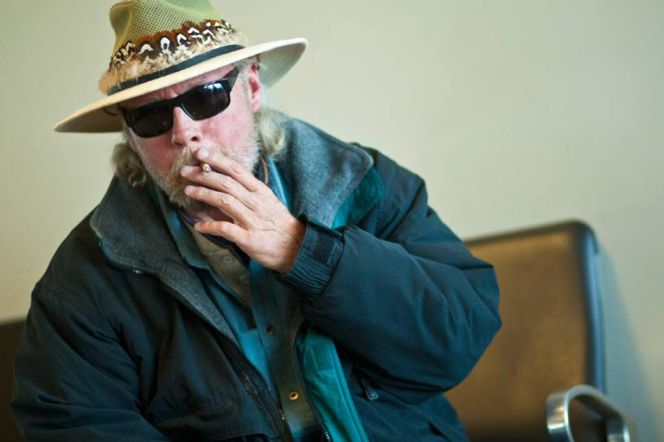 Chris Detrick  |   Tribune file photo A traveler smokes in the smoking lounge before his flight to Houston at the Salt Lake City International Airport Tuesday November 20, 2012.