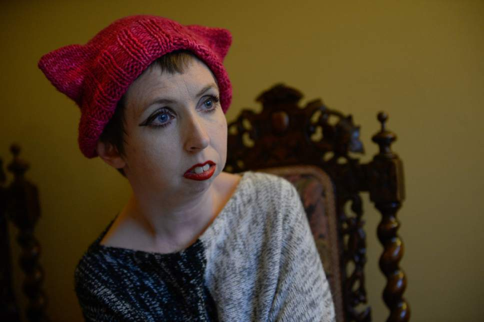 Francisco Kjolseth | The Salt Lake Tribune Psarah Johnson (cq) of Salt Lake plans to travel to Washington, DC to attend the women's march the day after Trump's inauguration. Recently she received her pink knit hat with cat ears being knitted by volunteers all over the world as part of the Pussy Hat Project and plans to wear it during the march in response to words spoken by Trump.