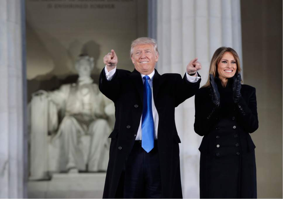 "President-elect Donald Trump and his wife Melania Trump arrive at a pre-Inaugural ""Make America Great Again! Welcome Celebration"" at the Lincoln Memorial in Washington, Thursday, Jan. 19, 2017. (AP Photo/Evan Vucci)"