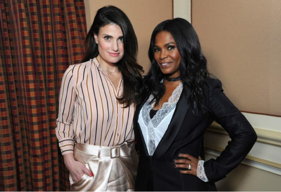 """Idina Menzel, left, and Nia Long pose for a portrait to promote their film """"Beaches"""" at the Winter Television Critics Association press tour on Friday, Jan. 13, 2017, in Pasadena, Calif. (Photo by Richard Shotwell/Invision/AP)"""