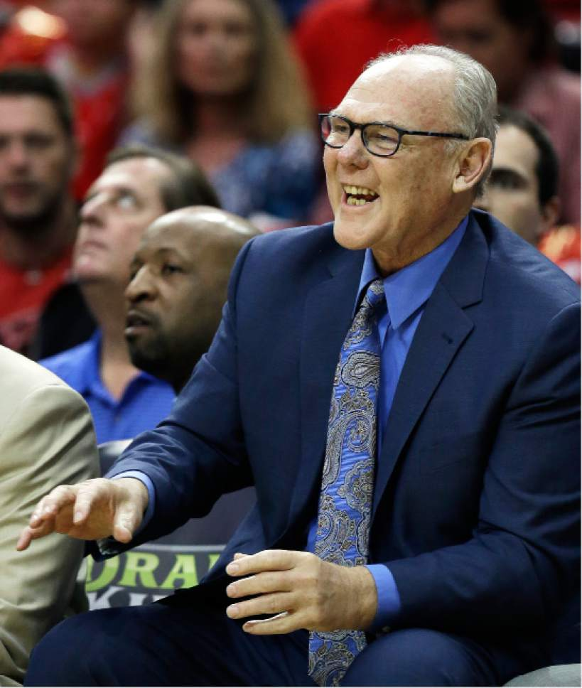 """FILE - In this April 13, 2016, file photo, Sacramento Kings coach George Karl yells to his players during the first half of an NBA basketball game against the Houston Rockets, in Houston. George Karl looks terrific as he ambles into the Tattered Cover Bookstore for a signing of his recently released """"Furious George"""" memoir that so infuriated Kenyon Martin. He's lost more than 50 pounds from his peak. He's eating right, drinking less and enjoying a peaceful existence after surviving cancer -- twice -- along with his lifelong addiction to the stress of coaching. But he'd jump right back into the grinder in a heartbeat if any owner decides to give him another chance. (AP Photo/Pat Sullivan, File)"""