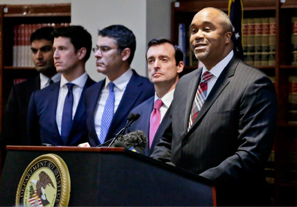 """U.S. attorney Robert Capers, right, speaks during a news conference, announcing charges for Mexican drug kingpin Joaquin """"El Chapo"""" Guzman as the murderous architect of a three-decade-long web of violence, corruption and drug trafficking, Friday Jan. 20, 2017, in the Brooklyn borough of New York.  Extradited Thursday from Mexico, Guzman was due later Friday in a federal court in Brooklyn. Prosecutors have sought to bring him to a U.S. court for years while he made brazen prison escapes and spent years on the run in Mexico.  (AP Photo/Mark Lennihan)"""