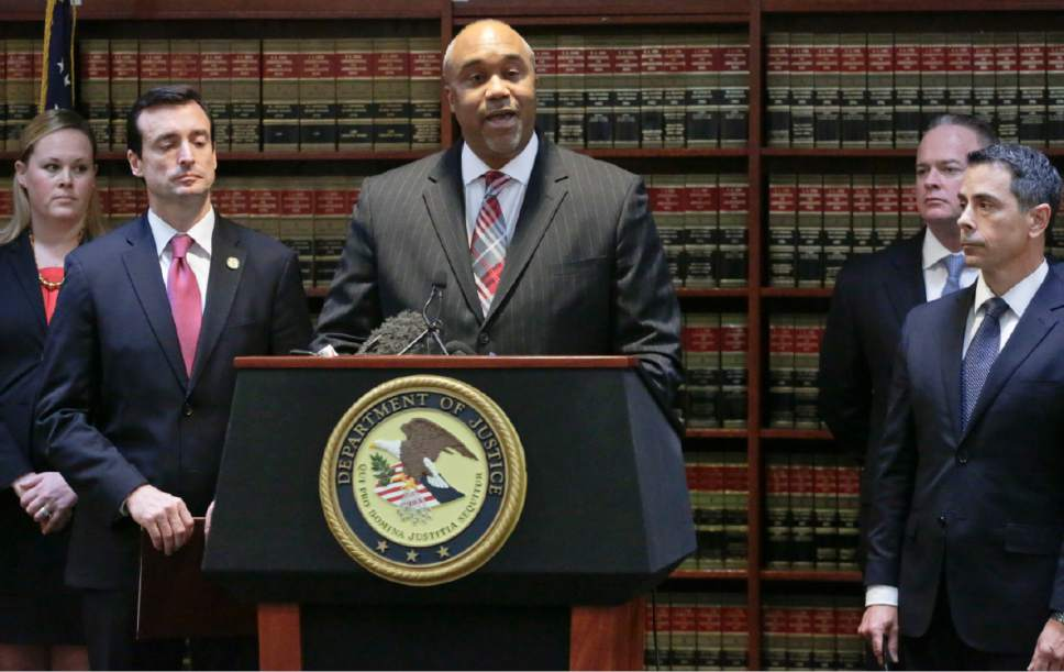 """U.S. attorney Robert Capers, center, speaks during a news conference, announcing charges for Mexican drug kingpin Joaquin """"El Chapo"""" Guzman as the murderous architect of a three-decade-long web of violence, corruption and drug trafficking, Friday Jan. 20, 2017, in the Brooklyn borough of New York.  Extradited Thursday from Mexico, Guzman was due later Friday in a federal court in Brooklyn. Prosecutors have sought to bring him to a U.S. court for years while he made brazen prison escapes and spent years on the run in Mexico.  (AP Photo/Mark Lennihan)"""