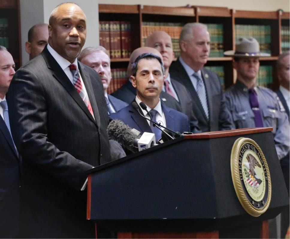 """U.S. attorney Robert Capers, left, speaks during a news conference, announcing charges for Mexican drug kingpin Joaquin """"El Chapo"""" Guzman as the murderous architect of a three-decade-long web of violence, corruption and drug trafficking, Friday Jan. 20, 2017, in the Brooklyn borough of New York.  Extradited Thursday from Mexico, Guzman was due later Friday in a federal court in Brooklyn. Prosecutors have sought to bring him to a U.S. court for years while he made brazen prison escapes and spent years on the run in Mexico.  (AP Photo/Mark Lennihan)"""