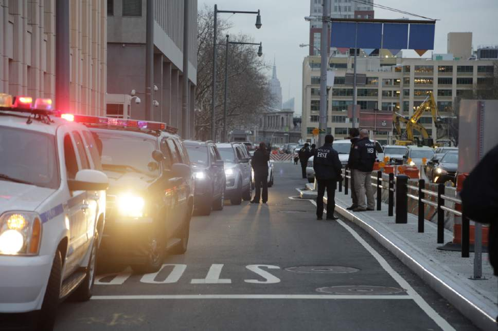 """The motorcade with Joaquin """"El Chapo"""" Guzman arrives at Brooklyn Federal Court on Friday, Jan. 20, 2017 in New York.   Guzman is expected to appear in federal court in New York today. He was brought to the United States from Mexico Thursday night to face drug trafficking and other charges. (AP Photo/Mark Lennihan)"""
